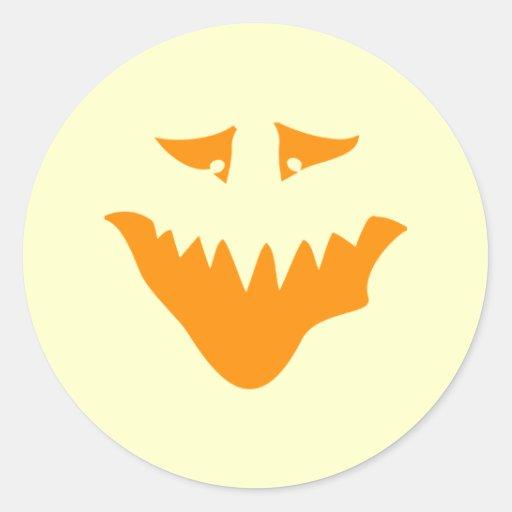 Orange Scary Face. Monster. Round Sticker