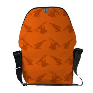 Orange ski pattern messenger bags