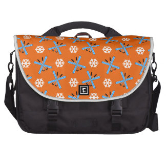 Orange skis and snowflakes pattern laptop commuter bag