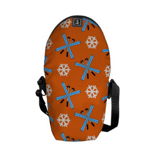 Orange skis and snowflakes pattern messenger bags