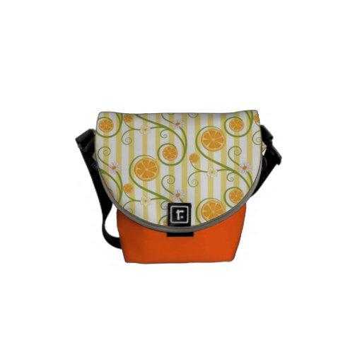 Orange slices and flower with orange stripes messenger bag