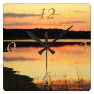 Orange sunset at the lake clock