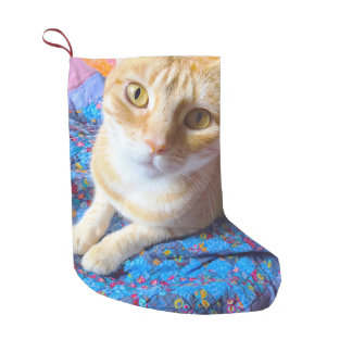 Orange tabby on quilt small christmas stocking
