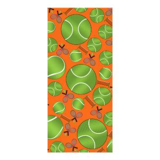 Orange tennis balls rackets and nets rack card