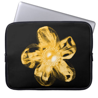 Orange tulle flower on black computer sleeve