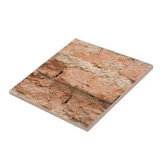 Orange Weathered Brick And Mortar Background Tile