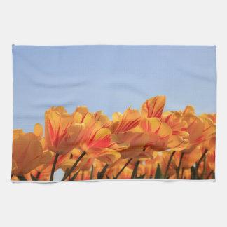 Orange yellow tulips by Thespringgarden Tea Towel