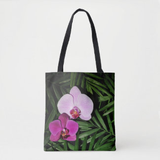 Orchids with palm leaves tote bag