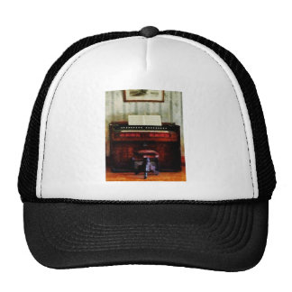 Organ and Swivel Stool Trucker Hat