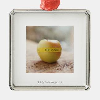 Organic sticker on apple christmas ornament
