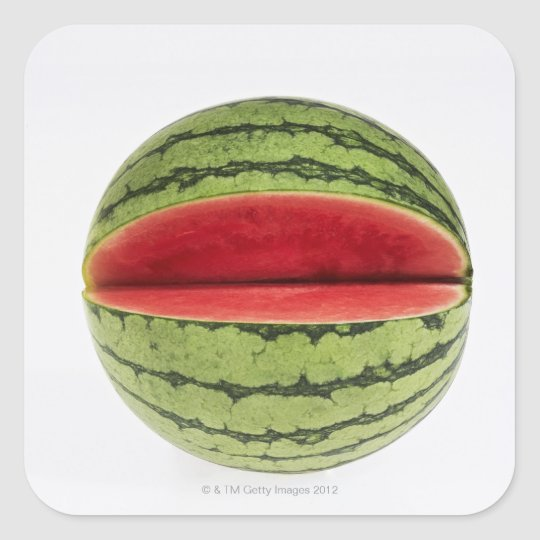 Organic watermelon with a slice cut into it,