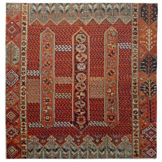 Oriental rug design in orange napkin