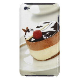 Ornate cheesecake on plate with coffee cup in iPod touch covers