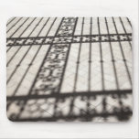 ornate iron fencing shadow on tile floor mouse pad