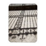 ornate iron fencing shadow on tile floor rectangular photo magnet