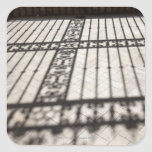 ornate iron fencing shadow on tile floor square stickers