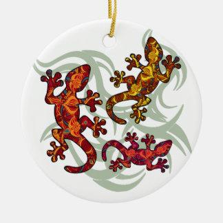 Ornate lizards round ceramic decoration