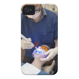 Orthodontist using UV light to set the concrete iPhone 4 Case-Mate Cases