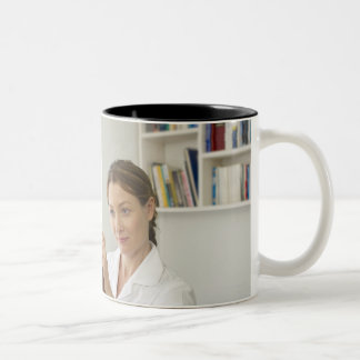 Osteopath treating patient. Two-Tone mug