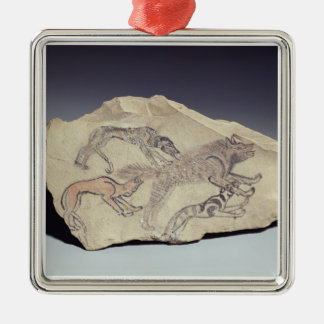 Ostracon depicting a dog chasing a hyena (limeston christmas ornament