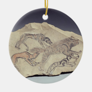 Ostracon depicting a dog chasing a hyena (limeston round ceramic decoration