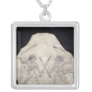 Ostrakon depicting two men fighting with silver plated necklace