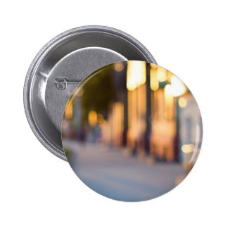 Out of focus image of streets and buildings 6 cm round badge