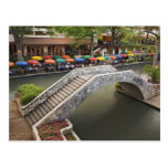 Outdoor cafe along River Walk and bridge over 2 Postcard