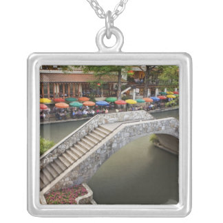 Outdoor cafe along River Walk and bridge over 2 Silver Plated Necklace