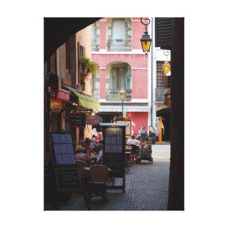 Outdoor Cafés, Restaurants in Quaint French Town Canvas Print