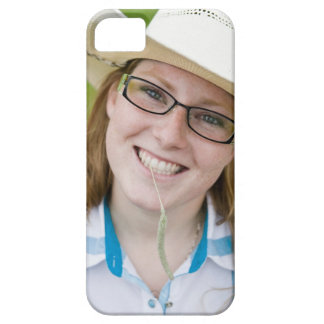 Outdoor portrait of smiling cowgirl biting grass barely there iPhone 5 case