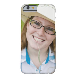 Outdoor portrait of smiling cowgirl biting grass barely there iPhone 6 case
