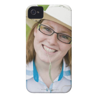 Outdoor portrait of smiling cowgirl biting grass Case-Mate iPhone 4 case
