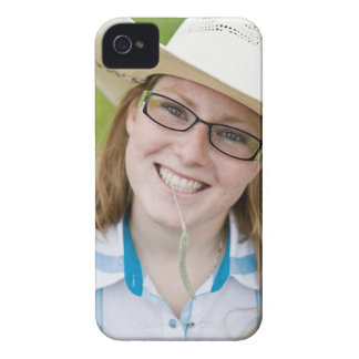 Outdoor portrait of smiling cowgirl biting grass iPhone 4 cases