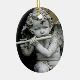 Oval Ornament Cherub Playing his Flute