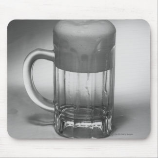 Overflowing beer glass mouse pad