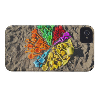 Overhead view of colourful children's plastic iPhone 4 cover