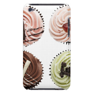 Overhead view of four cup cakes on white iPod Case-Mate cases