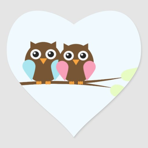 Owl couple on a branch