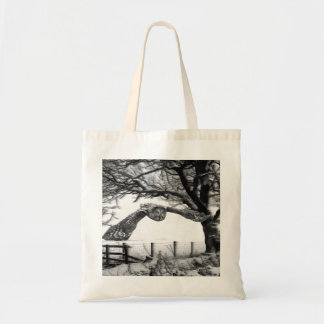 Owl flying in the snow tote bag