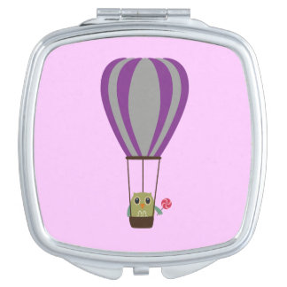 Owl in hot-air balloon with a lollipop mirror for makeup