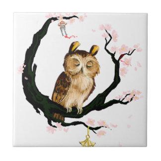 Owl on a sakura ceramic tiles