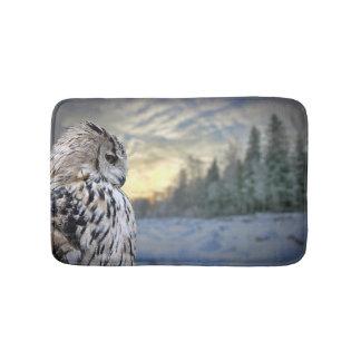 Owl portrait on winter forest background bath mat