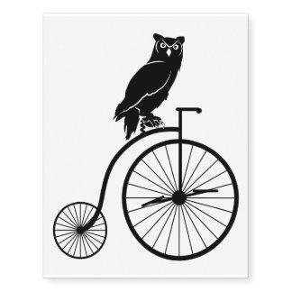 Owl Silhouette Riding a Bike