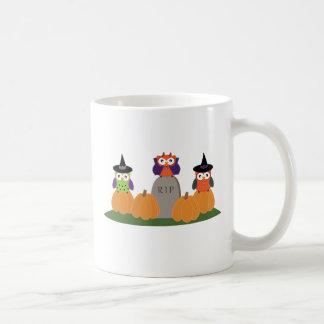 Owls in Halloween Costumes Sitting on Pumpkins Mug