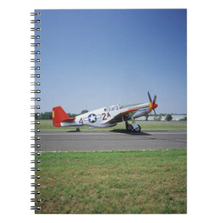 P-51 C Tuskegee Red Tail airplane at the CAF Air Notebooks