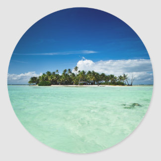 Pacific island with palm trees round sticker