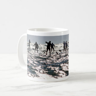 Paddleboarders on the sparkling sea coffee mug