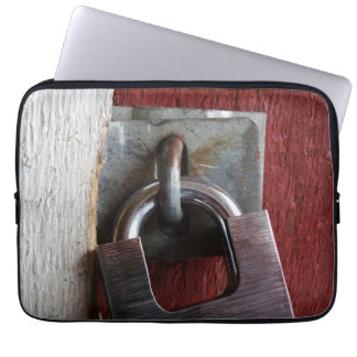 Padlock on old door laptop sleeve