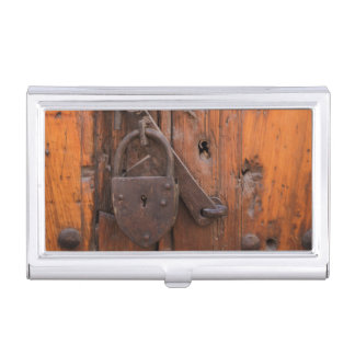 Padlock on wooden door business card holders